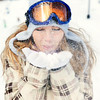 Female in Snowgear Blowing Snow